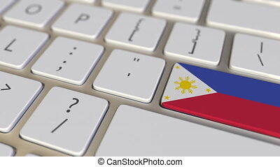 Key with flag of Philippines on the computer keyboard switches to key with flag of the USA, translation or relocation related animation