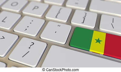 Key with flag of Senegal on the computer keyboard switches to key with flag of Great Britain, translation or relocation related animation