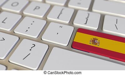 Key with flag of Spain on the computer keyboard switches to key with flag of France, translation or relocation related animation