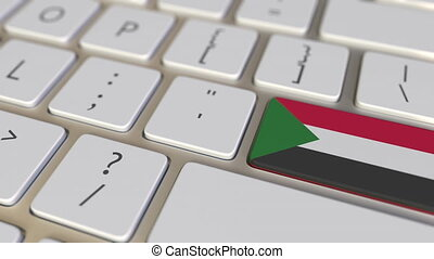Key with flag of Sudan on the computer keyboard switches to key with flag of China, translation or relocation related animation