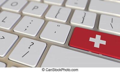 Key with flag of Switzerland on the computer keyboard switches to key with flag of Great Britain, translation or relocation related animation
