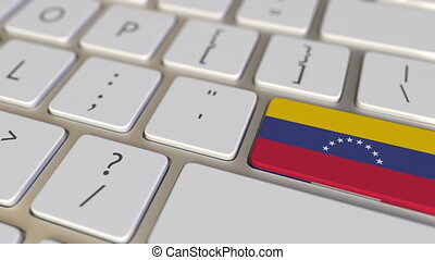 Key with flag of Venezuela on the computer keyboard switches to key with flag of France, translation or relocation related animation
