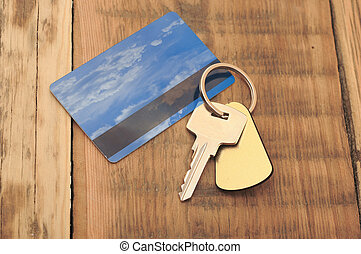 key with plastic card and reflection blue sky and clouds