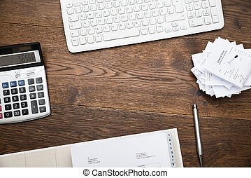 Keyboard And Calculator With Receipts - High Angle View Of...