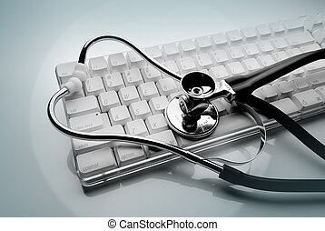 Keyboard and stethoscope - stethoscope on white computer...