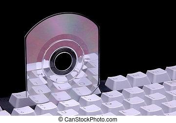 Keyboard & CD - Keyboard with Compact disc stuck between ...
