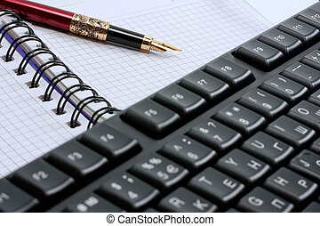 keyboard, note pad and classic gold fountain pen isolated on a white background