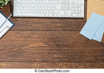 Keyboard on wooden desk in business workspace