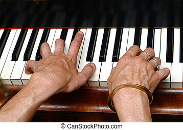 keyboard - two hands on piano keys