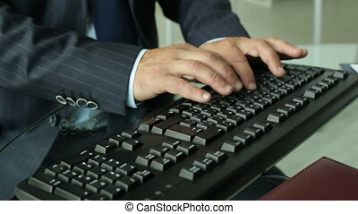 Keyboard typer - Close-up of a business worker inputting...