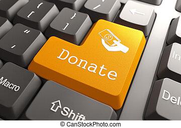 Orange Donate Button on Computer Keyboard. Internet Concept.