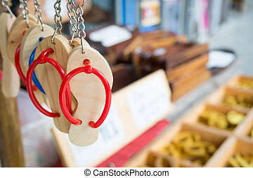 Keychain wooden shoes in a store.