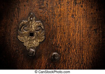 Keyhole on old wooden door