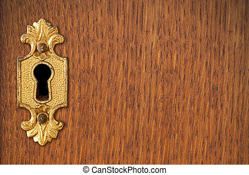 keyhole on wooden background