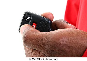 Keyless Entry Car - Man's hand on a keyless entry against...