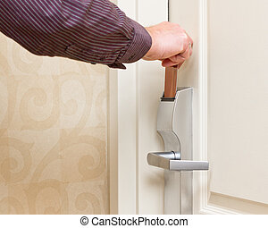 Keyless Entry - Closeup of man's hand opening keyless entry...