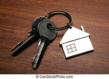 keys from the apartment with a keychain in the form of a house