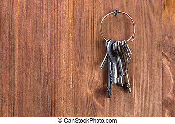 keys hanging on a wooden wall