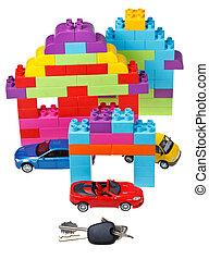 keys, model car, plastic block house