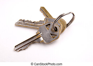 Keys on a ring - Group of three Keys isolated over white...