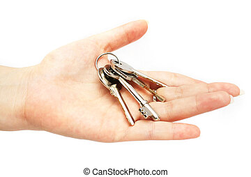 Keys On Hand - A bunch of keys on lady\\\'s hand over white...