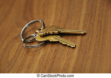 Keys - Detail of a pair of keys over wooden background