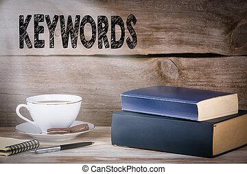 keywords., pilha livros, ligado, escrivaninha madeira