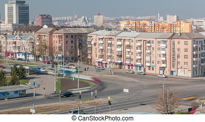 Kharkiv city from above timelapse. Defenders of Ukraine square with intersection. Tram stop and car traffic on the Moscow avenue. Aerial view to the city center and residential districts. Ukraine.