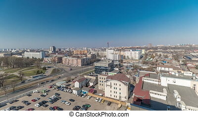 Kharkiv city from above timelapse. Defenders of Ukraine square with intersection and car parking. Tram stop and car traffic on the Moscow avenue. Aerial view to the city center and residential districts. Ukraine.