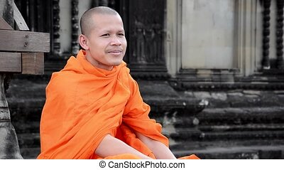 khmer monk portrait - cambodian monk smoking in angkor wat...