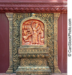 Khmer style wall relief in Phnom Penh, Cambodia