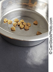 Kibble dog or cat food close up in stainless steel bowl