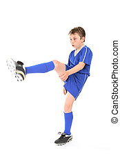 Kick - A boy dressed in soccer uniform kicking. Focus to...