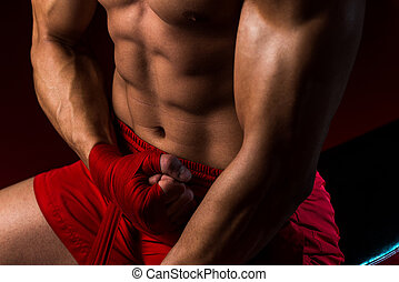 Kick Boxer Getting Ready - Muscled Boxer Wearing Red Strap...