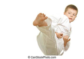 Kick - Karate boy making kick photo against white background...
