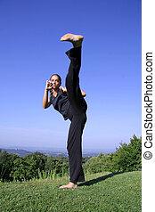 kick - attractive young woman practicing self defense