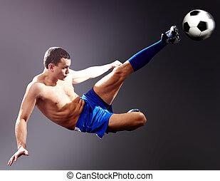 Kick - Professional sportsman kicks soccer ball