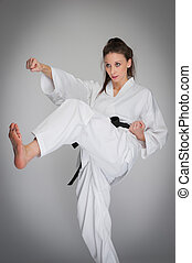 Kick Punch Self Defence Woman in Karate Training.