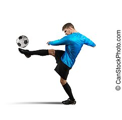 Kick the ball - Soccer player jumps and kicks the ball