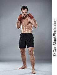 Kickbox fighter in guard stance