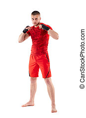 Young kickbox fighter in guard stance isolated on white