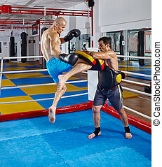 Kickbox fighters training in the ring - Two muay thai...