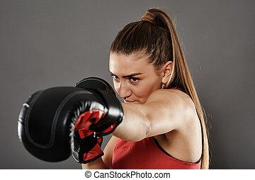 Kickbox woman left jab - Kickbox girl delivering a left jab,...