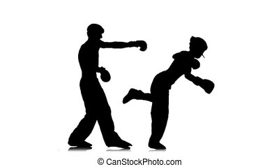 Kickboxer girl kicks on the head of an opponent. Silhouette. White background. Slow motion