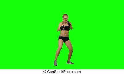 Kickboxer standing in the front and sends butted an opponent standing on the spot. Green screen