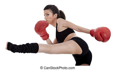 Kickboxing girl giving strong kick with her leg over white...