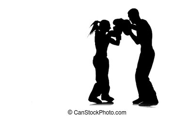 Kickboxing on boxing paws the girl beats feet on them the...