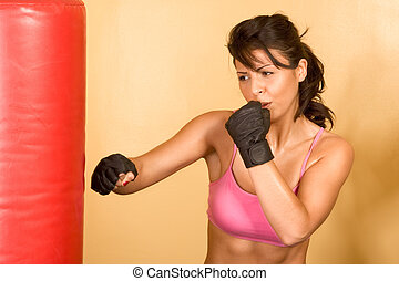 kickboxing training - Attractive female kickboxing with red...