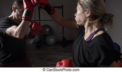 Kickboxing woman and a man boxing together as a stress...