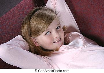 Kickin Back - pretty feminine preteen girl in pink laying on...